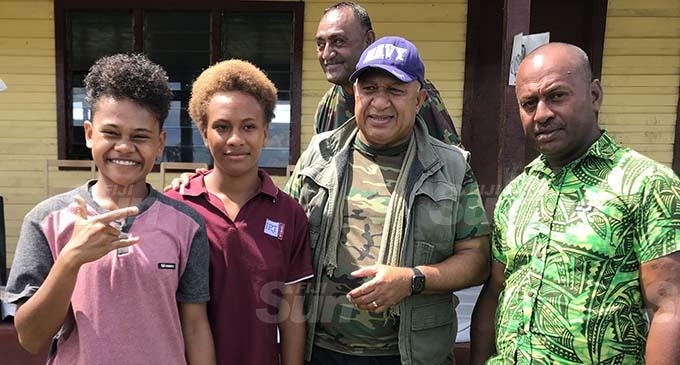 Prime Minister Voreqe Bainimarama with Bua Lomani village headman Ratu Viliame Tagivakatau (right) and villagers at Bua District School in Bua on January 13, 2021. Photo: Shratika Naidu