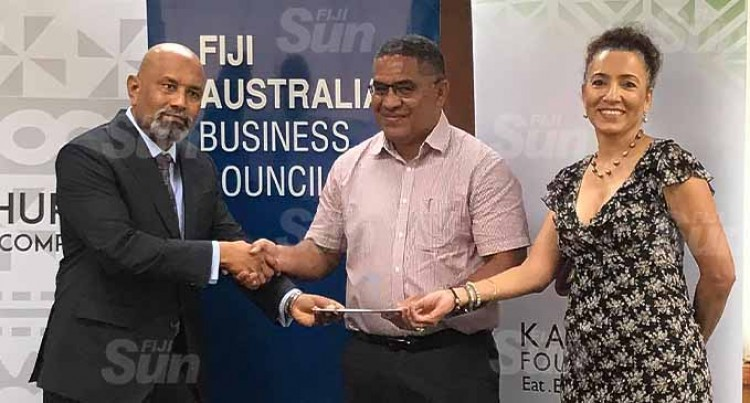 Business Council Presents $10k For TC Yasa Relief Fund