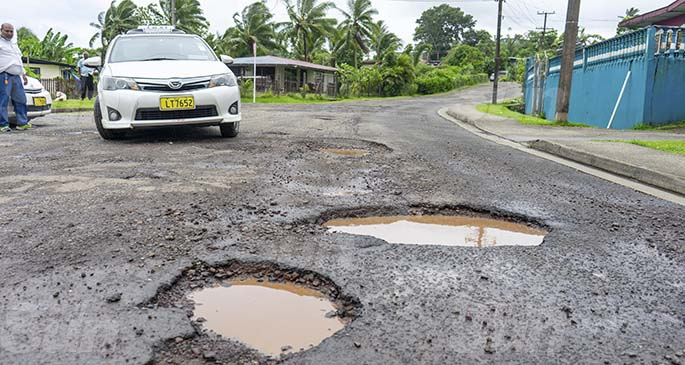 Potholes along Cunningham Stage One on the January 27, 2021. Fiji Roads Authority contractors have stepped up work to fix roads damaged by bad weather. Photo: Leon Lord.