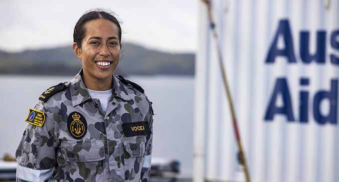 Fijian born Leading Seaman Communication and Information Systems Michelle Vocea stands on the flight deck of HMAS Adelaide in Fiji ready to assist areas affected by Tropical Cyclone Yasa.