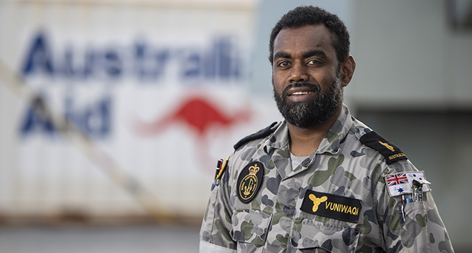 Fijian born Able Seaman Marine Technician Koloba Vuniwaqa stands on the flight deck of HMAS Adelaide in Fiji ready to assist areas affected by Tropical Cyclone Yasa.