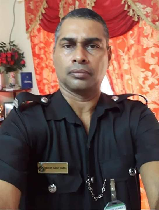 (In happier days....Accident victim, Police Constable Asaf Iqbal, 50.