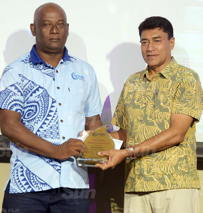 Vajira Piyasena Chief Executive Officer for Fiji Ports Corporation Limited (right) awards Parveen Kumar with Best Mechnical and Gear award during Fiji Ports Terminal Limited Employee award at Grand Pacific Hotel on February 20, 2021. Photo: Ronald Kumar.