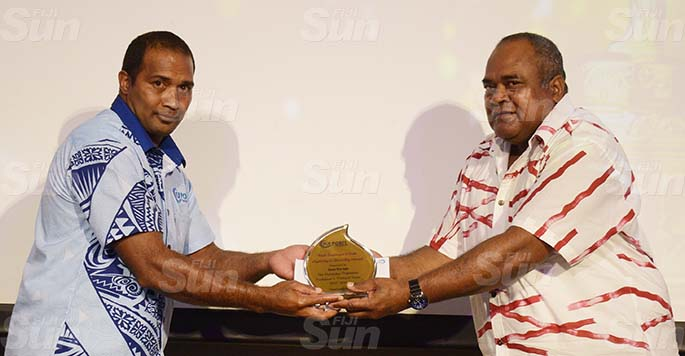 Fiji Ports Terminal Limited  Port Master Lesiasa Qonewai (right) awards Best Capturing and Recording awards winner Jona Narogo during Employee awards ceremony at Grand Pacific Hotel on February 20, 2021. Photo: Ronald Kumar.