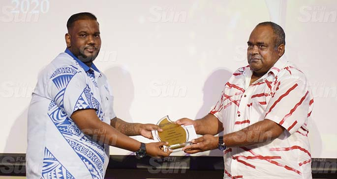 Fiji Ports Terminal Limited Port Master, Lasiasa Qonnewai (right) awards Ashnil Dutt with best General Administration award during their Employee award at Grand Pacific Hotel on February 20, 2021. Photo: Ronald Kumar.