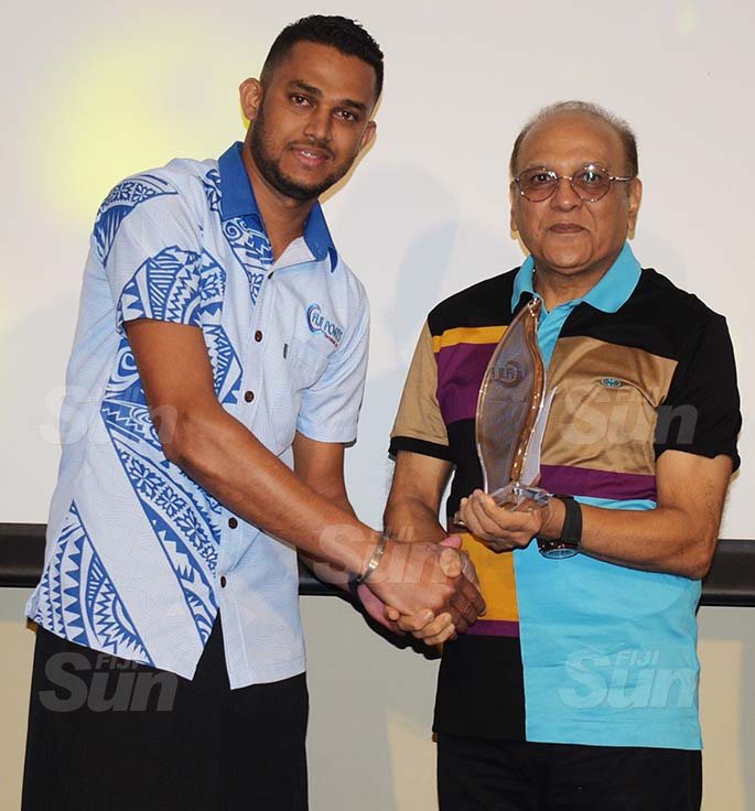Fiji Ports Terminal Limited Chairman Hasmukh Patel (right) awards Employee of the year award to Atish Kumar at Grand Pacific Hotel on February 20, 2021. Photo: Ronald Kumar.