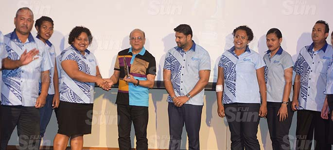 Fiji Ports Terminal Limited Chairman Hasmukh Patel awards Best Storage Department award to team Suva during their Employee award at Grand Pacific Hotel on February 20, 2021. Photo: Ronald Kumar.