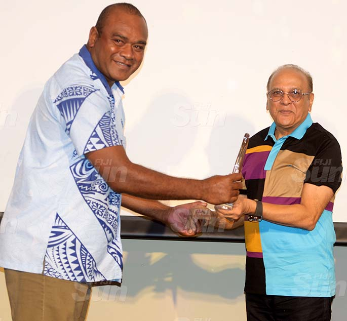 Fiji Ports Terminal Limited Chairman Hasmukh Patel awards Special Chairmans Award to Apete Tamani during their Employee award at Grand Pacific Hotel on February 20, 2021. Photo: Ronald Kumar.