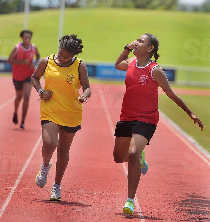 An early celebration by Katarina Benny (right) cost her 400meters senior girls final to Alanasio Rokobalini as she crossed the lane as she celebrated at ANZ Stadium on February 24, 2021. Photo: Ronald Kumar.