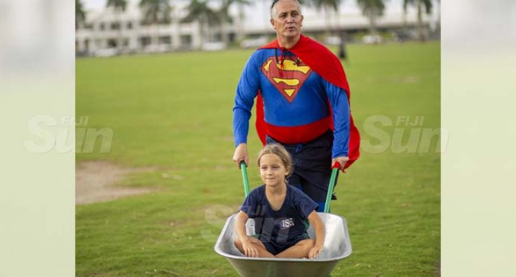 It's Super Daddy- Senior British Diplomat Races For Charity