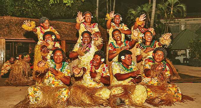 Women perform a meke at Turtle Island Resort. Photo:  Turtle Island