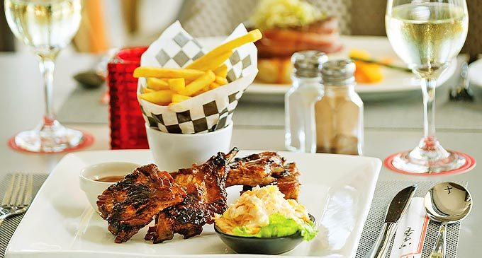 BBQ baby pork ribs offered as lunch at Club 57 and Bistro.