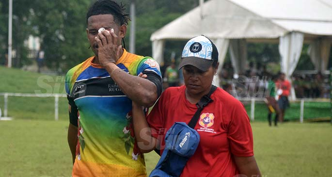 Raiwasa Taveuni player, Manueli Maisamoa, is escorted by a medical official at Prince Charles Park, Nadi, on February 27, 2021.Photo: Waisea Nasokia
