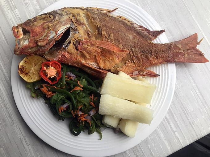 Fried whole fish with side ota salad.