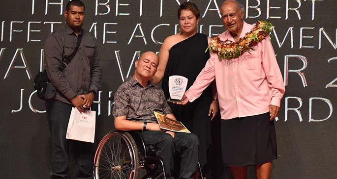 Speaker of Parliament Ratu Epeli Nailatikau presents Joshko Wakaniyasi with the Lifetime Achievement Award during the HomeCare Independent National Disability Awards at the National Gymnasium on March 27, 2021. Photo: Parliament of Fiji