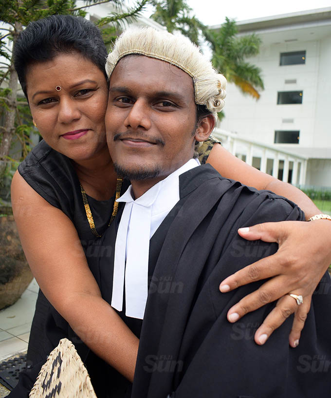 Anita Singh congratulate her son, Sidhant Singh following his admission into the Bar by Acting Chief Justice Kamal Kumar at Grand Pacific Hotel on March 12, 2021. Photo: Ronald Kumar.
