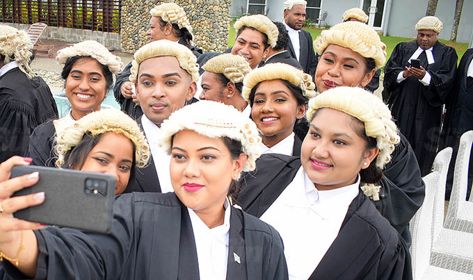 Shyna Singh (with phone) with fellow law students from USP admission into the Bar by Acting Chief Justice Kamal Kumar at Grand Pacific Hotel on March 12, 2021. Photo: Ronald Kumar.