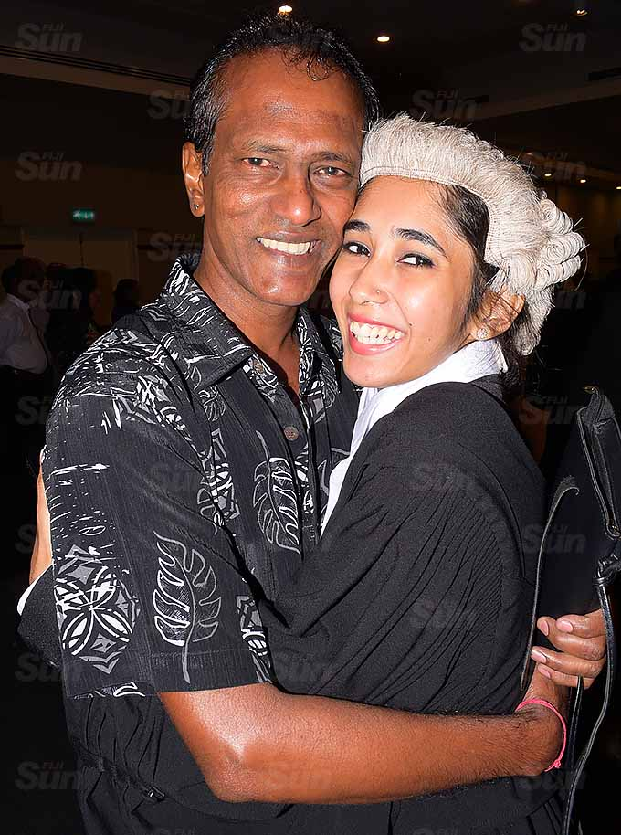 Shivani Chand gets a hug from her father, Dhiren Chand following her admission into the Bar at Grand Pacific Hotel on March 12, 2021. Photo: Ronald Kumar.
