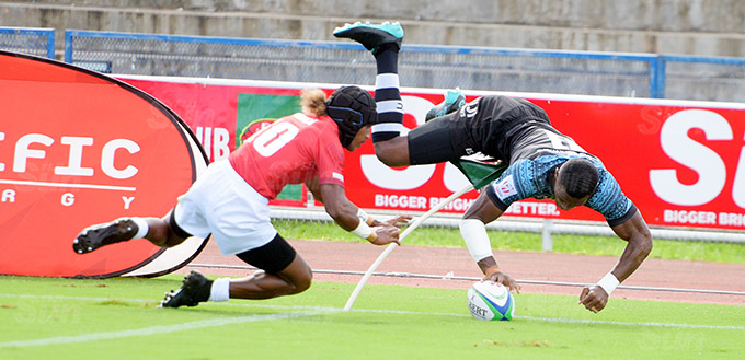 Jiuta Wainiqolo of Fiji Shadow dives in for a try against Moala Vonokula during Marist Sevens at ANZ Stadium on March 26, 2021. Photo: Ronald Kumar.