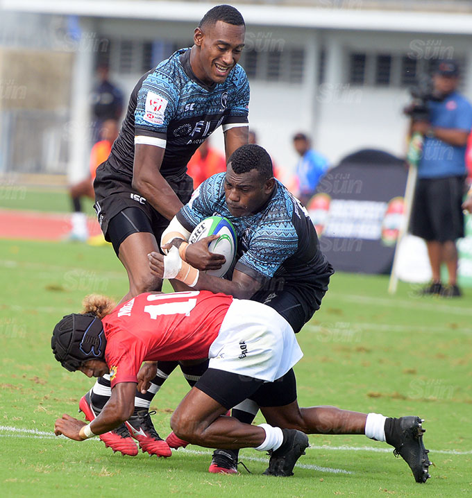 Livai Ikanikoda of Fiji Shadow on attack against Moala Vonokula during Marist Sevens at ANZ Stadium on March 26, 2021. Photo: Ronald Kumar.