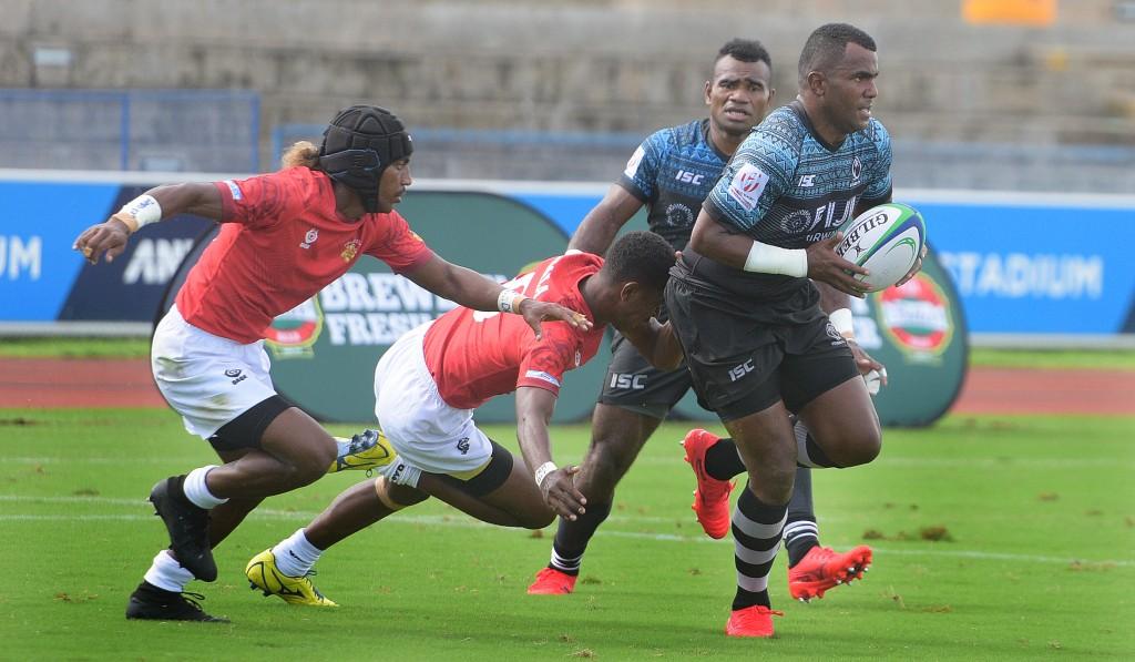 Kitione Taliga of Fiji Shadow on attack against Moala Vonokula during Marist Sevens at ANZ Stadium on March 26, 2021. Photo: Ronald Kumar.