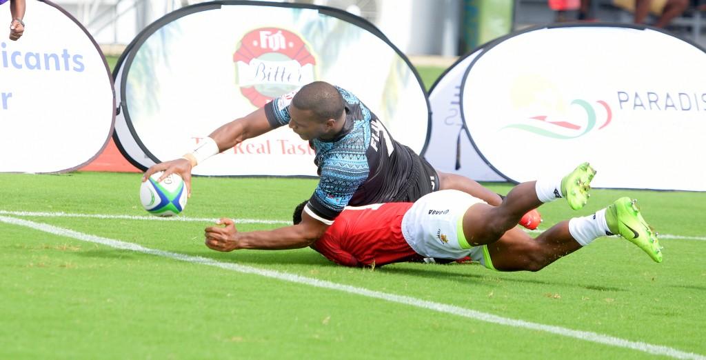 Josua Vakuruinabili of Fiji Shadow dives in for their first try against Moala Vonokula during Marist Sevens at ANZ Stadium on March 26, 2021. Photo: Ronald Kumar.