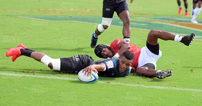 Napolioni Bolaca of Fiji Shadow reached out to the try line for the second try against Moala Vonokula during Marist Sevens at ANZ Stadium on March 26, 2021. Photo: Ronald Kumar.
