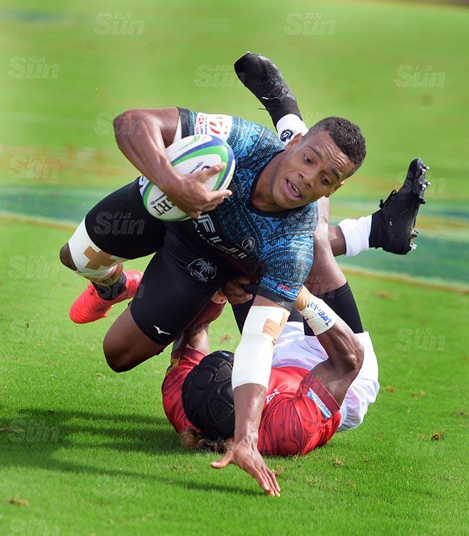 Napolioni Bolaca of Fiji Shadow dives in against Moala Vonokula during Marist Sevens at ANZ Stadium on March 26, 2021. Photo: Ronald Kumar.