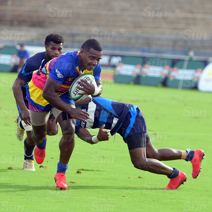 Kaminieli Rasaku of Tabadamu on attack against Loloma's during Marist Sevens at ANZ Stadium on March 26, 2021. Photo: Ronald Kumar.