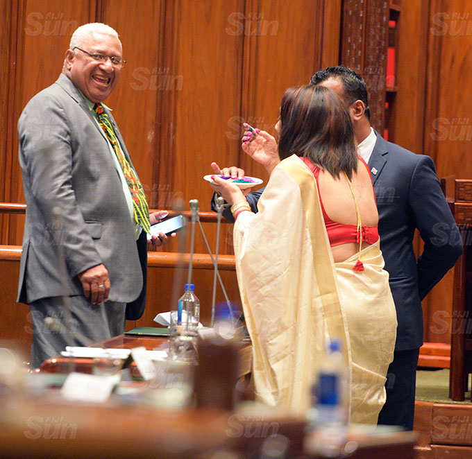 Sharing the Holi colours... Prime Minister Voreqe Bainimarama , Assistant Minister Alvick Maharaj and Minister for Education Rosy Akbar after Parliament session on March 26, 2021. Photo: Ronald Kumar.