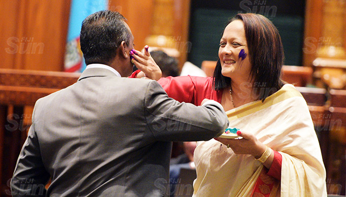 Sharing the Holi colours..Assistant Minister for Transport Vijay Nath and Minister for Education Rosy Akbar after Parliament session on March 26, 2021. Photo: Ronald Kumar.