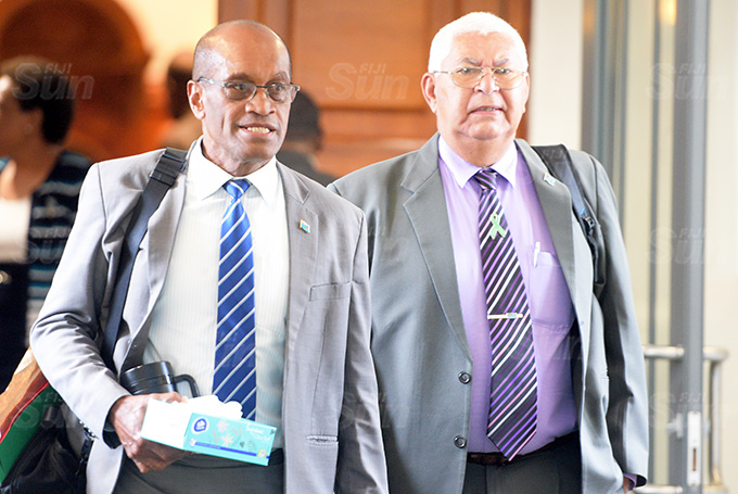 Minister for Lands Jone Usamate and Assistant Minister for Health Alex O'Connor outside Parliament session on March 26, 2021. Photo: Ronald Kumar.