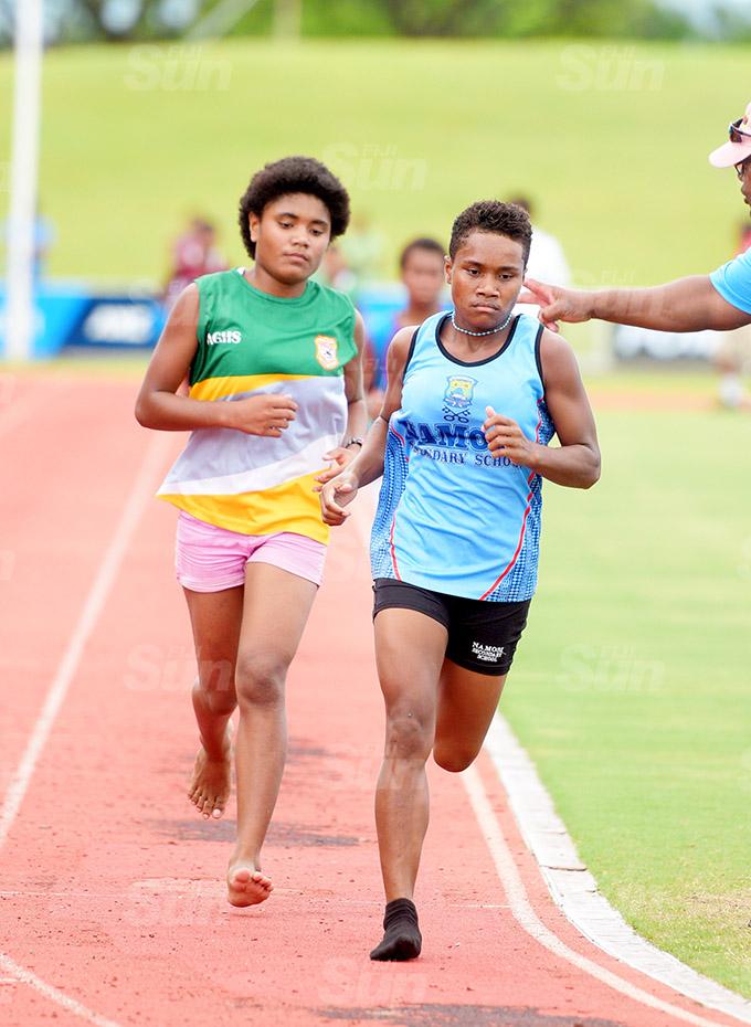 Roela Kalaumaira (right) of Namosi Secondary School make her move to win the Suva Zone 1 3000meters final at ANZ Stadium on March 16, 2021. Photo: Ronald Kumar.