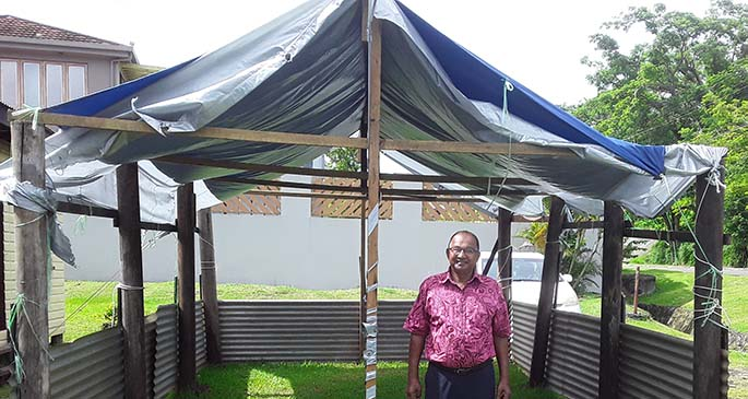 Shiloh Tabernacle Christian Fellowship Church pastor Kamla Prasad outside the temporary shed at Naiyaca subdivision on March 7, 2021, that was set up after the fire in January this year.