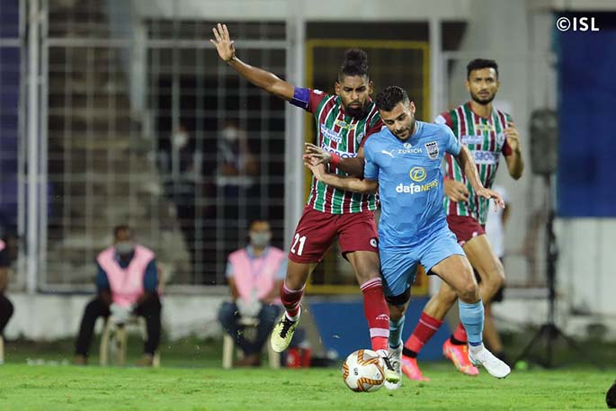 Roy Krishna (left) is challenged during the Indian Super League final against Mumbai City on March 13, 2021. Roy has scored 14 goals with eight assists during the competition. Photo: ISL