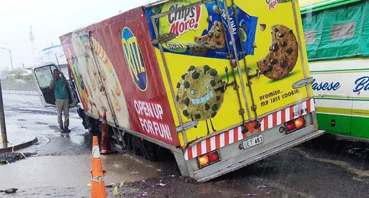 Truck Lands In A Nausori Pothole