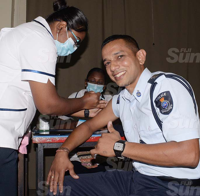 Police Inspector Nitesh Narayan gets his COVID vaccination shot from staff nurse, Melissa Naicker at the Police Gym in Nasova on April 6, 2021.Photo: Ronald Kumar