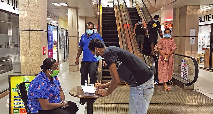 The management of CJS Mall in Labasa are recording relevant details of the public. Photo: Laisa Lui.