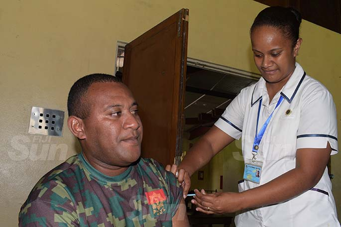 Setefano Koroivalu of RFMF gets his COVID vaccination shot from staff nurse, Aqela Susu at Queen Elizabeth Barracks, in Nabua, on April 6, 2021. Photo: Ronald Kumar