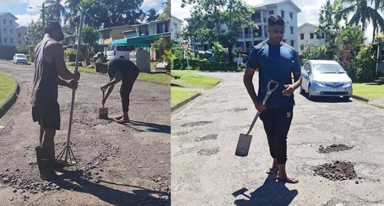 Dean And Workers Fill Potholes In Suva Street