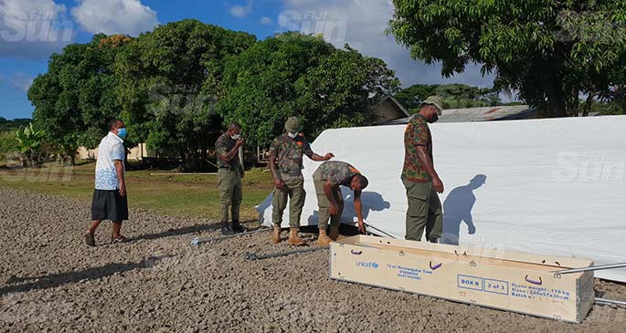 Personnel from the RFMF, the Fiji Police Force and FEMAT work tirelessly to get the field hospital ready for operation today. Photo: Nicolette Chambers