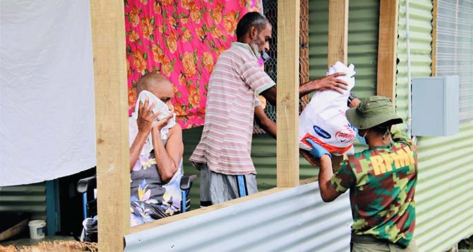 Republic of Fiji Military personnel delivering a food pack to a family along Khalsa Road in Nasinu on May 2, 2021. Photo: Ministry of Health and Medical Services