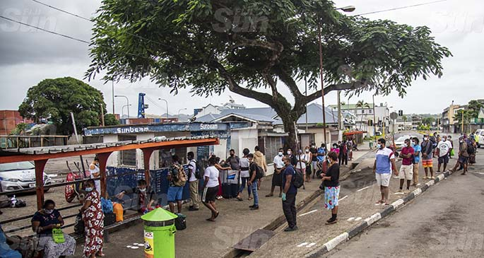 People line up at the Sunbeam Transport Limited ticket booth in Suva as they try to return to their homes in Lautoka on May 9, 2021. Photo: Leon Lord