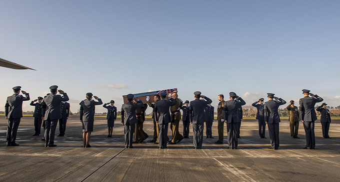 Casket of the late WO1 Vatoga flanked by members of the Royal New Zeland Defence Force as he prepares to depart New Zealand on his final journey home.