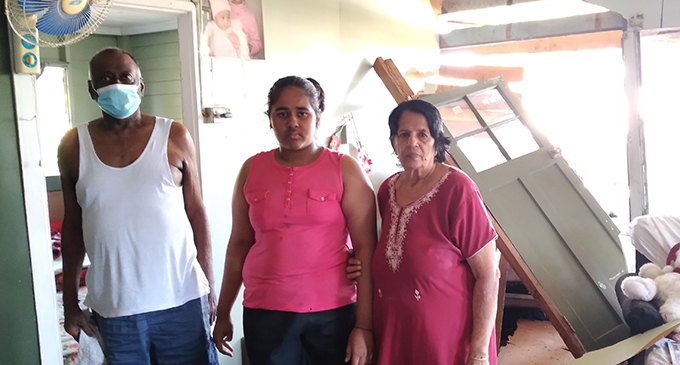 Madhwan Goundar (left) with his granddaughter, Nidhi Goundar (middle) and wife, Him Devi (right) inside their damaged home at Field 40, Lautoka on July 9, 2021. Photo: Nicolette Chambers