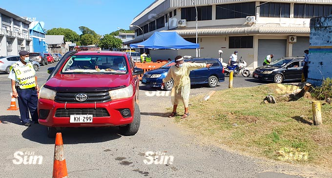 A health official and Police officer assisting the people at the first drive-through vaccination at the South Seas Club on July 21, 2021. Photo: Nicolette Chambers.