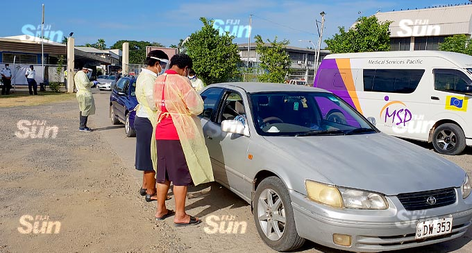 Health officials attend to those who turned up to receive their COVID-19 vaccine at the first drive-through vaccination at the South Seas Club on July 21, 2021. Photo: Nicolette Chambers.