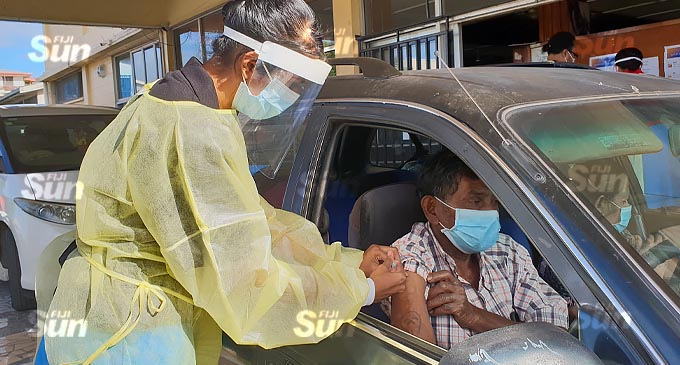 Lautoka resident, Ravin Chand receives his second dose of the AstraZeneca vaccine at the first drive-through vaccination at the South Seas Club on July 21, 2021. Photo: Nicolette Chambers.