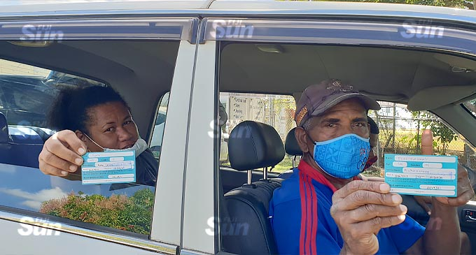 Peni Nasilokia and his wife, Fane Tilly after getting their first dose of the AstraZeneca vaccine at the first drive-through vaccination at the South Seas Club on July 21, 2021. Photo: Nicolette Chambers.