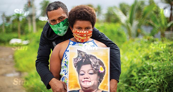 Rupeni Camini and his eldest daughter, Repeka Revuya, hold a picture of her mother, Amelia Bukayara. Photo: Leon Lord